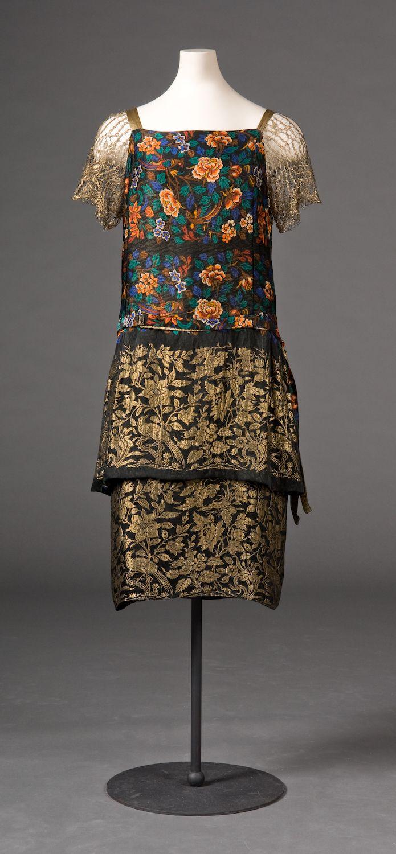 Evening Dress, 1925-27, metallic gold lace, gold lame ribbon and metalllic machine lace. Art deco interpretation of Chinese design motifs.