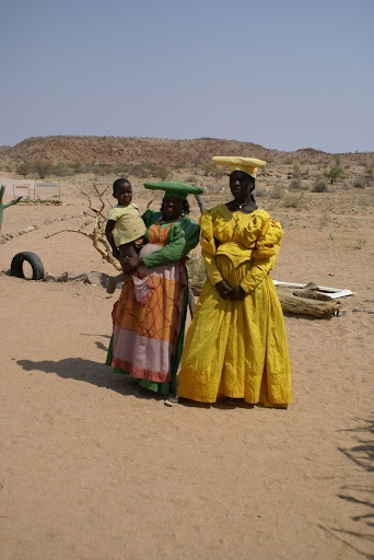 Africa   Herero Ladies, Namibia.  Their attire is reminiscent of the dress the German colonial occupiers introduced, but the hats represent bull horns - the Herero are cattle people. The Herero are a people belonging to the Bantu group, with about 240,000 members alive today. The majority live in Namibia, with the remainder living in Botswana and Angola.