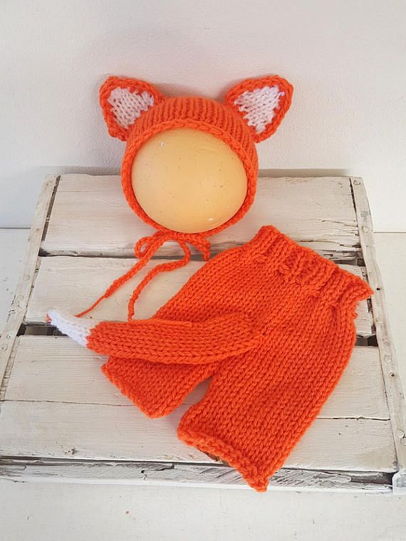 Sweet little baby fox outfit  Knitted baby outfit. Shorts with ribbed waist, and draw-string tie Bonnet with fox ears. Made in a soft acrylic yarn  Newborn size Perfect as a photo prop , or for your special baby outing  Easy to wash. Simply gently wash by hand, and lay flat to dry   Shipping from South Africa to the UK is approx 14 business days, Elsewhere up to 25 business days, so please bear that in mind when ordering. Join me on Facebook to get all the latest news : http://www.f...
