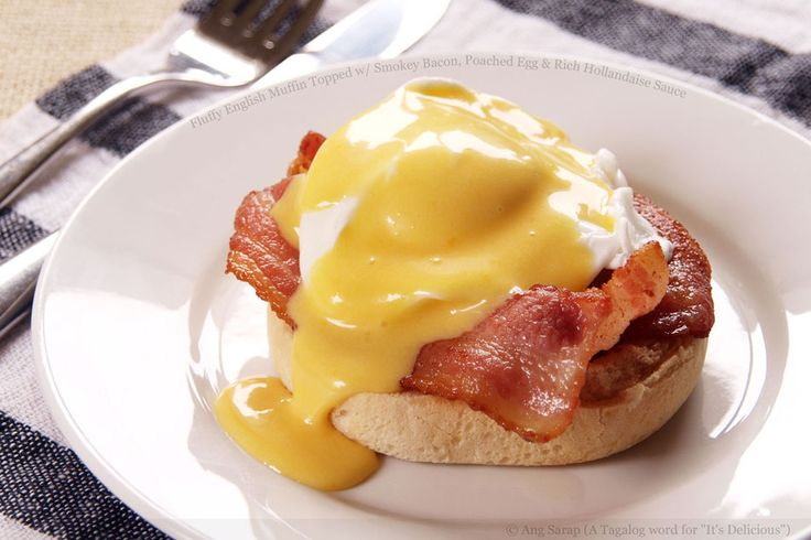 Fluffy English Muffin Topped with Smokey Bacon, Poached Egg and Rich Hollandaise Sauce