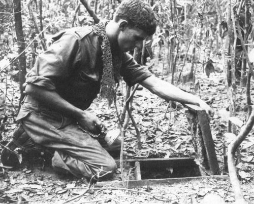 An Australian soldier about to check a Vietcong tunnel during Operation Crimp