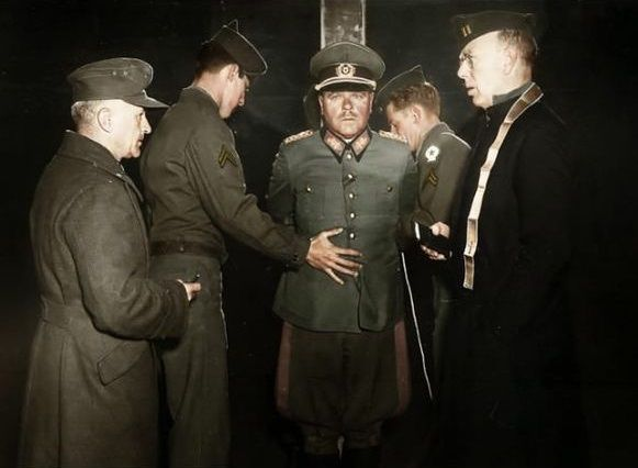 Nazi General Anton Dostler is tied to a stake before his execution by firing squad, 1945.