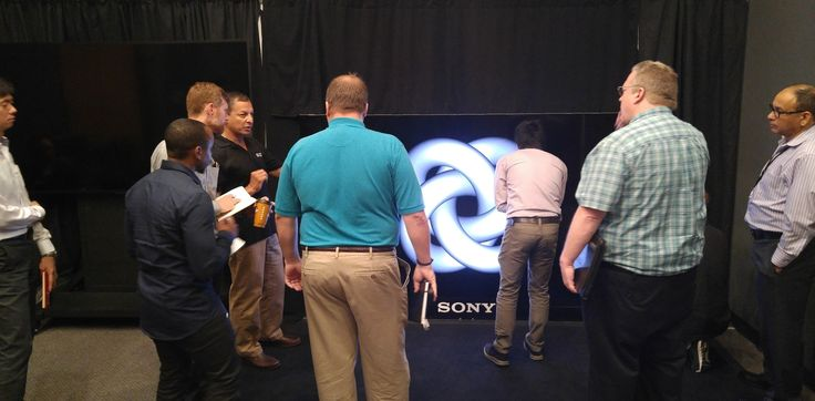 IGI President Pat Hernandez in a technical discussion with automotive designers regarding the Sony Canvas product that was demonstrated at 4K Forum 2016 in Detroit.