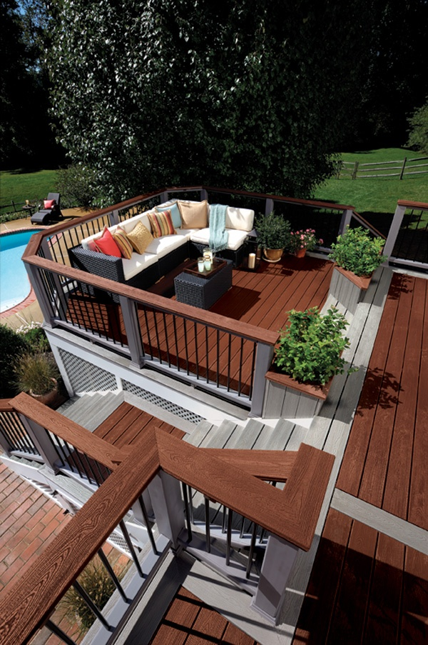 Trex Transcend Decking in Fire Pit and Gravel Path. Trex Transcend Railing in Fire Pit and Gravel Path with contemporary balusters in Charcoal Black.