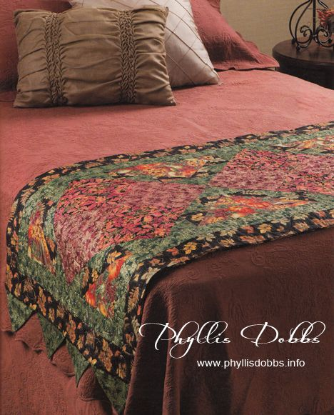 """Bed Runners add such a dramatic decorative accent to a bed and bedroom. This bed runner """"Warm Splendor"""" was designed by Phyllis Dobbs and is in a new quilt book """"Bed Runners & More"""" by House of White Birches."""