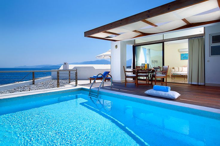 St Nicolas Executive Suite with private pool. St Nicolas Bay Resort, Agios Nikolaos Crete. Come equipped with one Double French Bed or either with two Twin Beds,custom made furniture. They feature remote control Air- Condition unit, remote