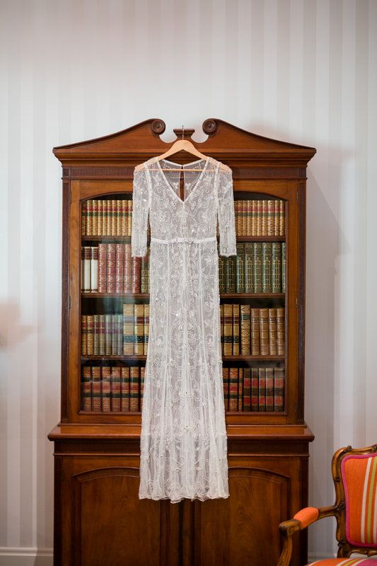 Stunning lace wedding dress with the perfect backdrop for a wedding set in a book barn.  // Hilary Cam Photography Bendooley Estate