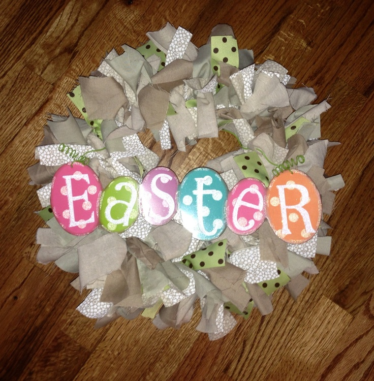 "Easter Rag Wreath. Used a wire 12"" frame. 4 dif fabrics & 1 ribbon cut into 2X10 strips & tied onto wreath frame."