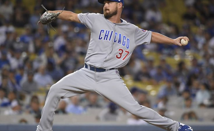 Tigers say former Cubs pitcher Travis Wood has torn knee ligament