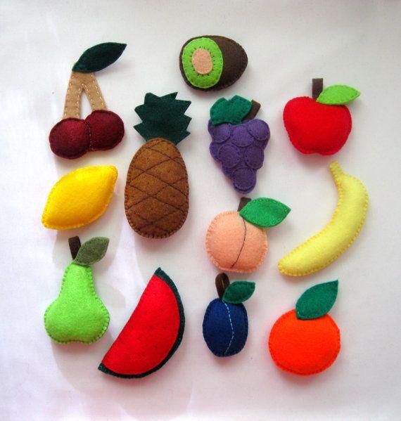 Felt Magnet 12 Fruit Play Set  - Apple , pear , plum , peach , orange , lemon ,kiwi , banana , cherry , grape , pineapple , watermelon slice. $39,99, via Etsy.