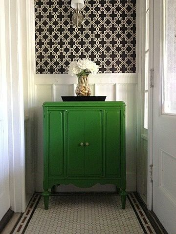 We have a lot of bold colors in our house already, but I have been looking for a way to make our 1950's black and white bathroom more modern. Love the kelly green look!