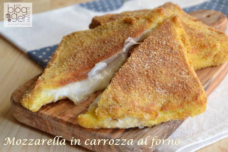Mozzarella in carrozza, cotta al forno con un filo d'olio, è un piatto semplice e veloce alla portata di tutti, con una croccante panatura esterna.