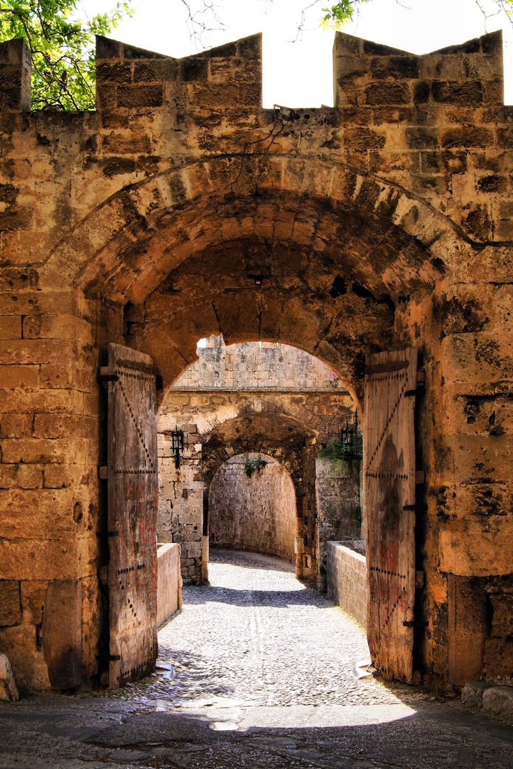 Ancient gate in the stone walls surrounding Rhodes Old Town