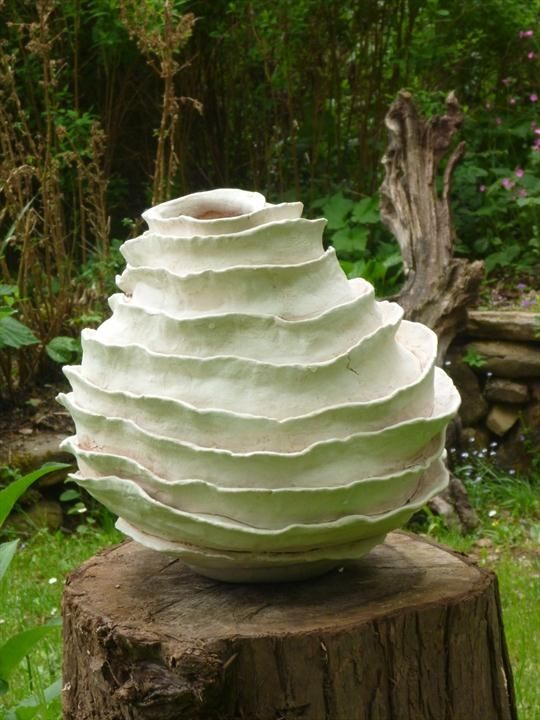 Layered form. Hollow form with flanges. Stoneware with porcelain slip. Pauline Lee