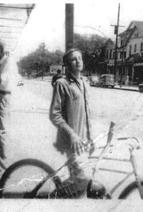 Elvis as a teenager in Memphis at the 550 block of Poplar Avenue. Story about the photo in the new Graceland blog.