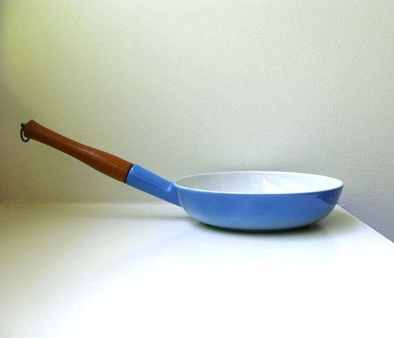 Danish Modern, shiny blue enamel on cast iron saute pan with a long teak handle - dating from the late 50s through the 60s. On the outside,