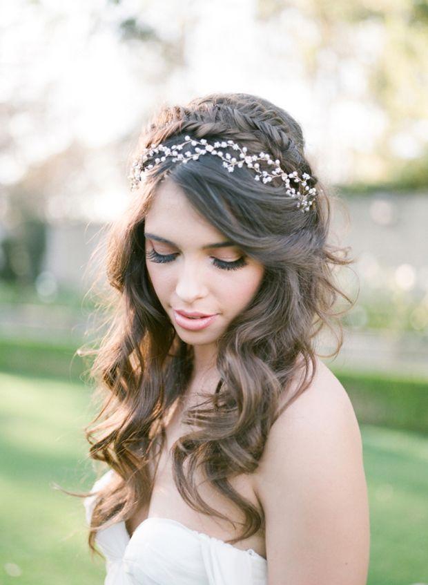 Braided half up half down wedding hairstyle with vine