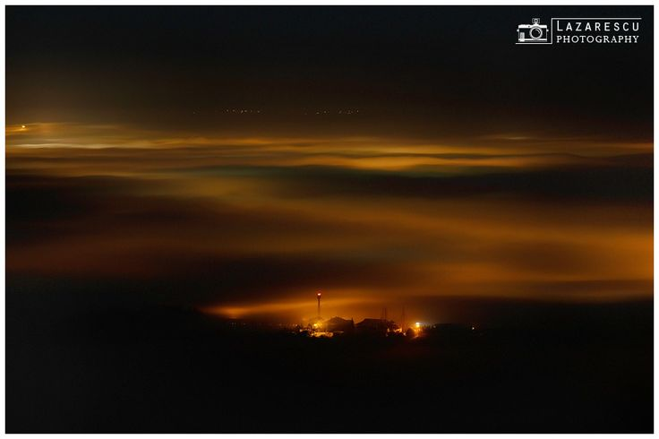 Fog layers - Waves of fog over the city by night.