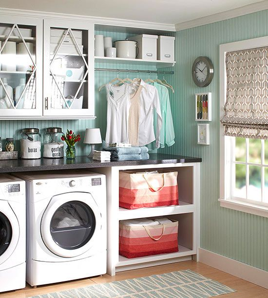 For more expansive laundry spaces, you may have room for the little extras -- a hanging rod, for example, or open shelves for laundry baskets. This pretty assembly keeps the space looking neat and tidy with a few extras, including mullions on the glass doors, uniformly colored containers, and restrained punches of pattern and color.