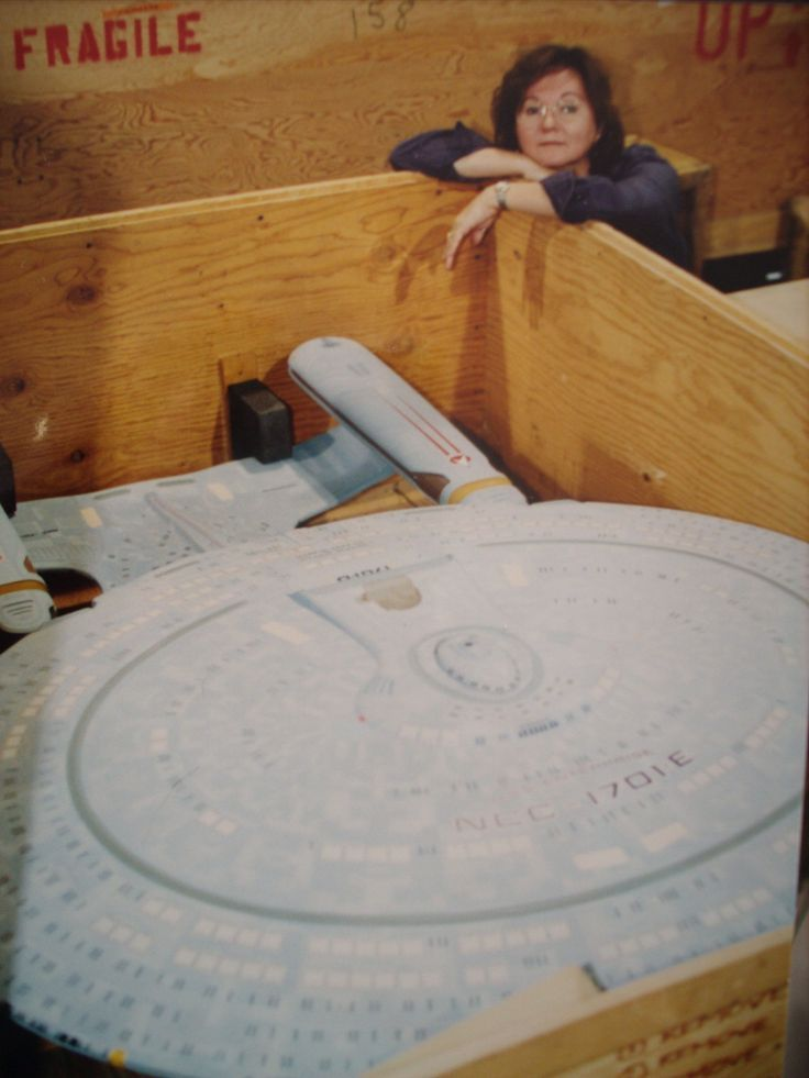 The starship USS Enterprise NCC-1701-D Special Effects Model arrives at studios of Paramount Pictures Television from Lucas Films  Industrial Light and Magic ( ILM )  for Star Trek :The Next Generation series back in 1987. Note : In this photo on the hull of the saucer section. Someone made a boo boo by putting an E instead of a D on the registry. Oops !