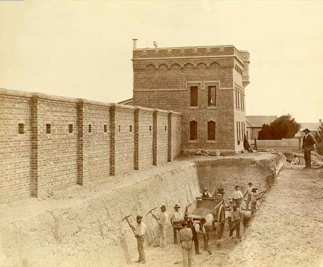 This photograph was taken by Charles Nettleton 14 May 1885 showing workmen digging the moat around Fort Queenscliff.