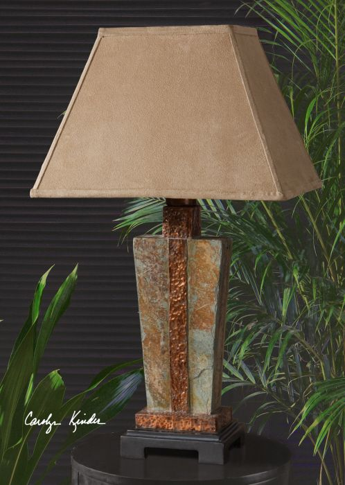 This indoor/outdoor lamp is made of real hand carved slate with hammered copper details. The rectangle bell shade is a brushed suede, weather resistant textile. Due to the natural material being used each piece will vary.  Designer:Carolyn Kinder Wattage:100W Number of Bulbs:1 Dimensions:29 H Shade 12 W X 17 D (in) Weight (lbs):18 Ship Via UPS:Yes