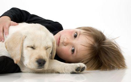1354098 - child with labrador retriever puppy