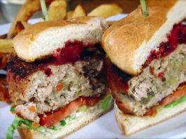 Christmas Burger — The Ace (Toronto) : Celebrate the holiday anytime with a turkey burger featuring a stuffing center (made with plenty of sage). The patty is roasted (instead of grilled) and topped with a cranberry and bourbon compote, as well as lettuce and tomato.