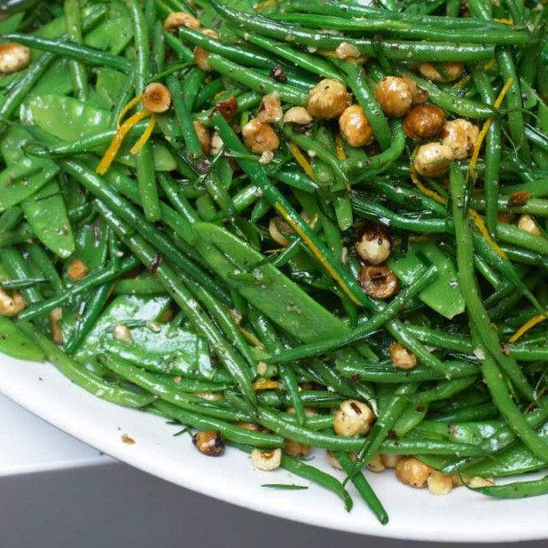 "French beans and mangetout with hazelnut and orange l (""Mangetout"" - meaning ""eat it all"" - refers to snow or snap peas.)"
