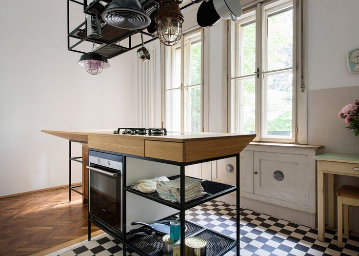 Munich architecture studio ifub has overhauled a apartment in vienna uncovering original details like parquet flooring and adding contemporary lighting and