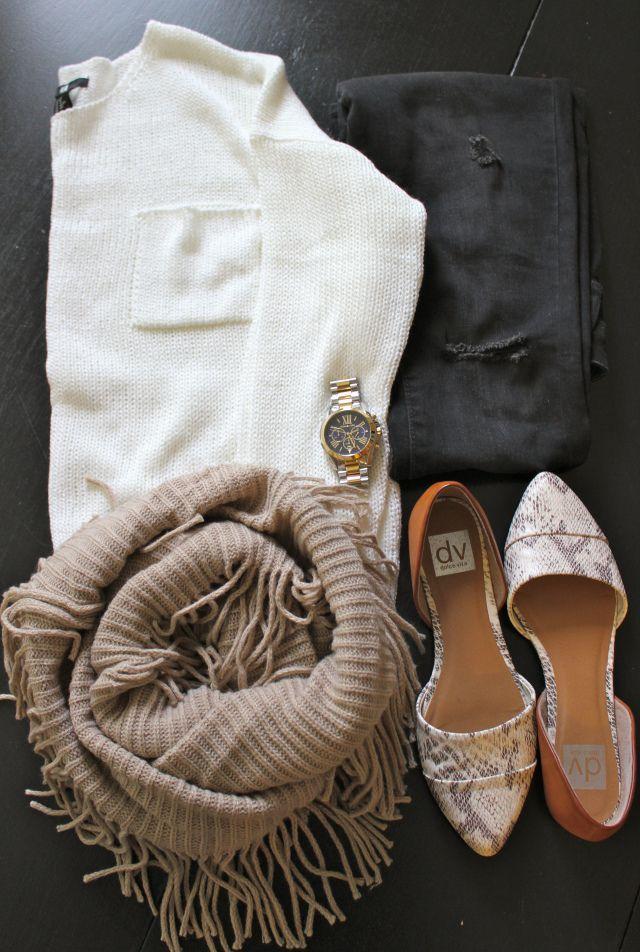 black distressed skinny jeans; cream loose knit sweater; fringe scarf; snake skin flats