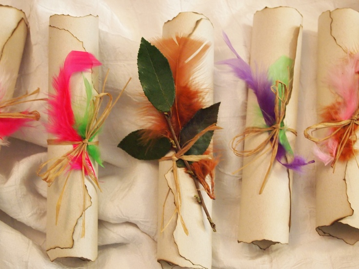 Pirate & Fairy Party Invitations (center Pirate).  burned edges printed on spreckled heavy paper stock and a cool brown font tied with a real branch with leaves & tea stained raffia for boys.  For the girls Fairy Invitations used various colored feathers  tied with tea stained raffia.