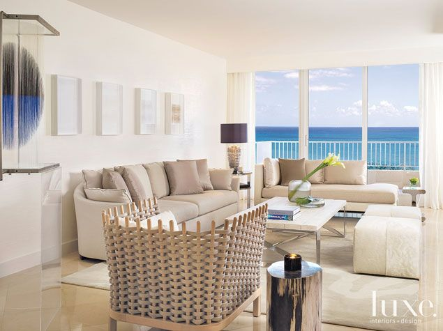 Oceanfront condo gets a warm aesthetic interior design for Condo living room ideas pinterest