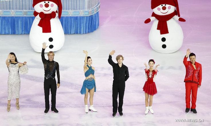 Chinese skater Chen Lu, Evgeni Viktorovich Plushenko of Russia, Meryl Davis and Charlie White of the United States and Chinese Shen Xue and Zhao Hongbo (L - R) wave to the spectators during the opening ceremony of the ISU World Figure Skating Championships 2015 at Crown Indoor Stadium, Oriental Sports Center in Shanghai, China, on March 25, 2015