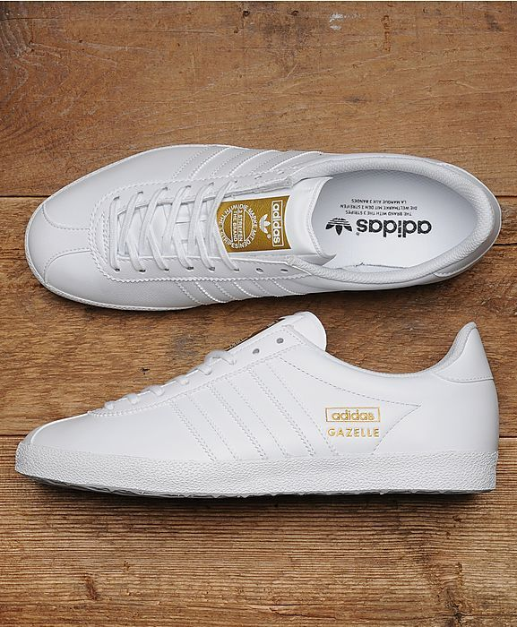 adidas Originals Gazelle OG Leather: adidas Originals present the Gazelle, originally released in 1968 it gained its popularity as a running shoe but through the 80s became popular on the football terrace. Still highly revered today, this style comes in a white leather upper, features a full lace up fastening, tonal three stripe branding and gold 'GAZELLE' branding on the side panels. Other details include printed branding on the tongue, tonal panelling on the toe and tonal textures midsole.