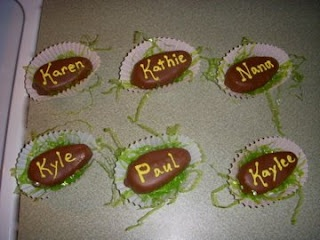 Easter Place cards!  But yummy!  Reeses Peanut butter eggs with the names piped on with frosting.