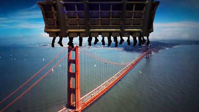 A Soarin' ride vehicle high above the Golden Gate Bridge and the San Francisco Bay