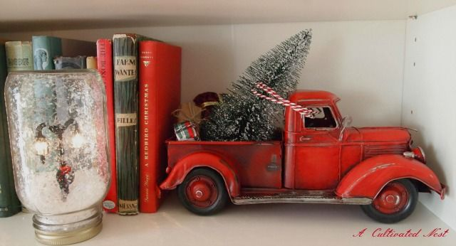 toy truck with Christmas tree We need to do this with Mom's village @Megan Kidwell  Bebe wants to put up the village this year, or maybe just part of it.