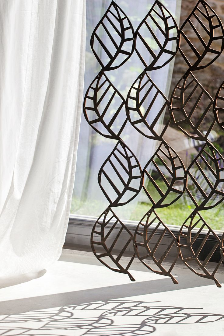 Wooden lace is room devider or window cover. The wooden lace is inspired by extra fine knitted Haapsalu lace shawls: their ethereal leaf patterns, fragility, rhythm and logic. #habitare2014 #design #sisustus #messut #helsinki #messukeskus