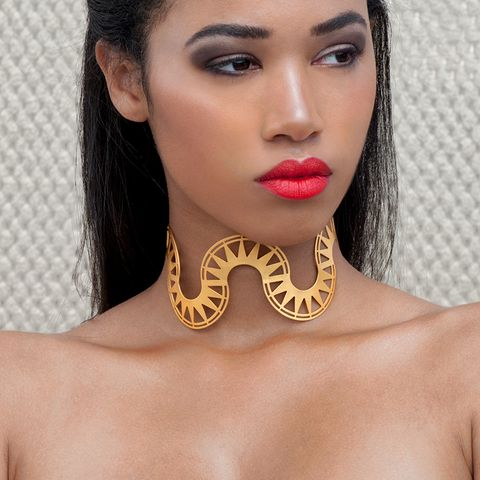 """A statement piece that can transform your entire outfit!  A beautiful handcrafted choker from yellow gold plated silver 925 featuring a series of semicircles decorated with the rays of the sun, giving the impression of the wave. The """"Bolge"""" choker ties on the back with a chain making it easy to adjust to any size and embrace the neck properly.  Tip: It goes perfectly with a simple low neck dress without any other accessories."""