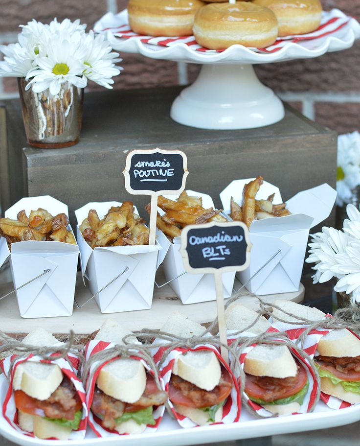 Canada Day Food Table - lots of Canadian food ideas here for your Canada Day party! Poutine, maple doughnuts, Canadian BLTs.
