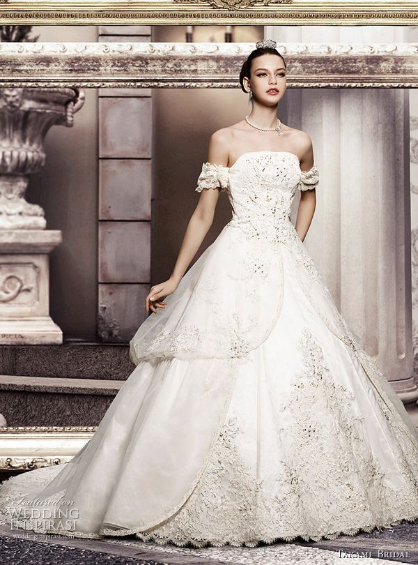 Wedding gown with flounced sleeves from the Royal Wedding collection by Takami Bridal.