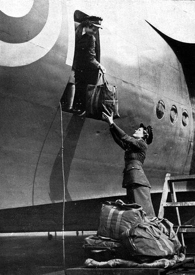 Short Sunderland flying boat, with WAAFS loading gear