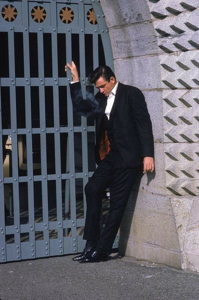 Johnny Cash having a smoke before going on stage at Folsom prison 1968.