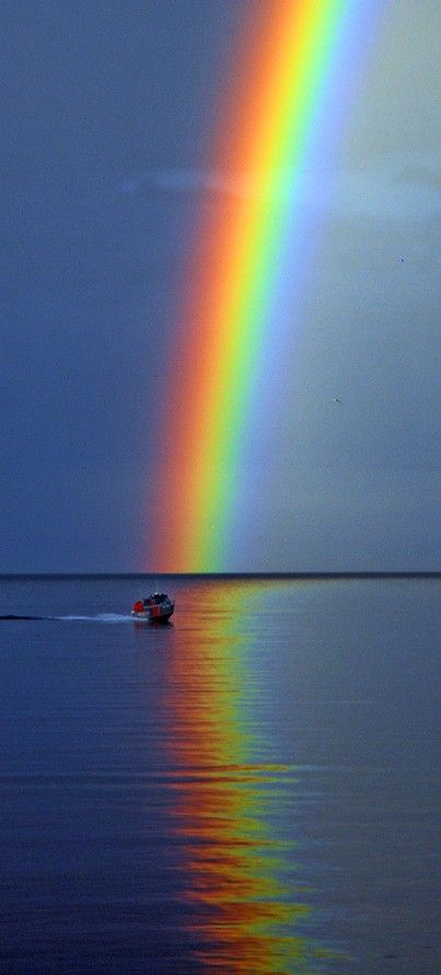 A rescue boat passes in front of a beautiful rainbow on Lake Ontario in Burlington, Ontario, Canada Very close to where I live !!