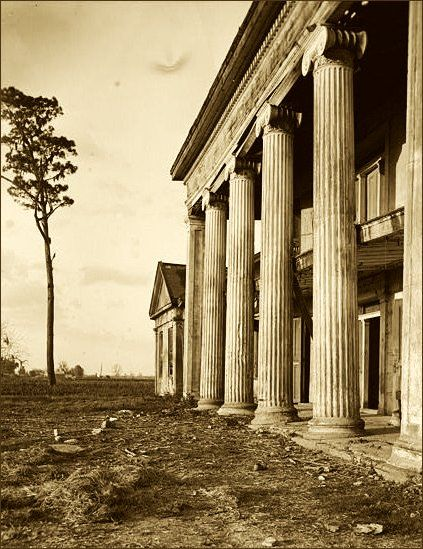 Woodlawn Plantation The Greek Revival in Louisiana had two major characteristics, first, the development of the old French raised cottage into a more or less square building with a hipped roof and surrounded on the four sides by columns.  Here two large wings are added to a familiar type of Louisiana house, forming an unusual ornamental composition.