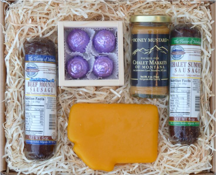Big Sky Country Gift Box.  One of our most popular gift boxes.  Montana shaped cheddar cheese, 2 beef sausages, huckleberry cordials and Chalet Honey Mustard.  Made in Montana.