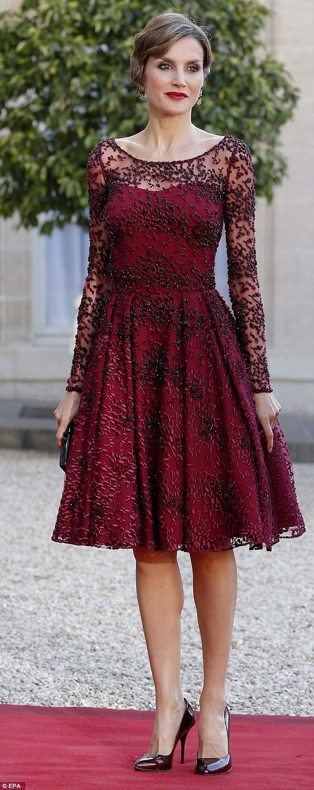 Queen Letizia looked perfect in plum as arrived at a state dinner in France with her husband King Felipe