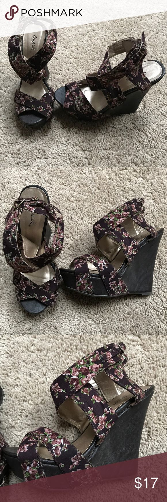 Floral Qupid wedge strappy heels Cutest floral strappy wedges with very little wear. I adore these but I had foot surgery a few years ago and I wore these maybe twice I just couldn't handle the heel!! I can't find a size on them but I swear they were labeled as a 6.5. Dark brown and burgundy. Qupid Shoes Wedges