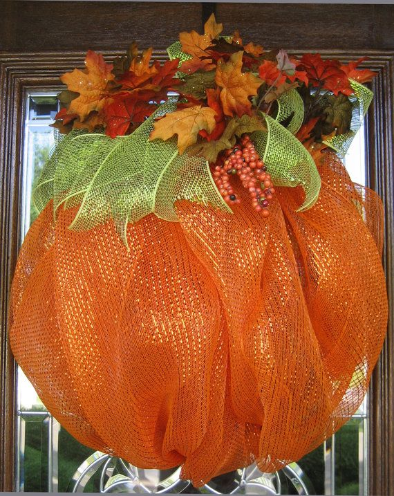 I can make this!  Get ready for Fall, Halloween and Thanksgiving with this beautiful pumpkin! It is made of deco mesh and measures 25x23 and is accented with green mesh ribbon and colorful leaves!